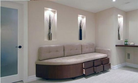 interior renovation of the basement with bright colors with a sofa