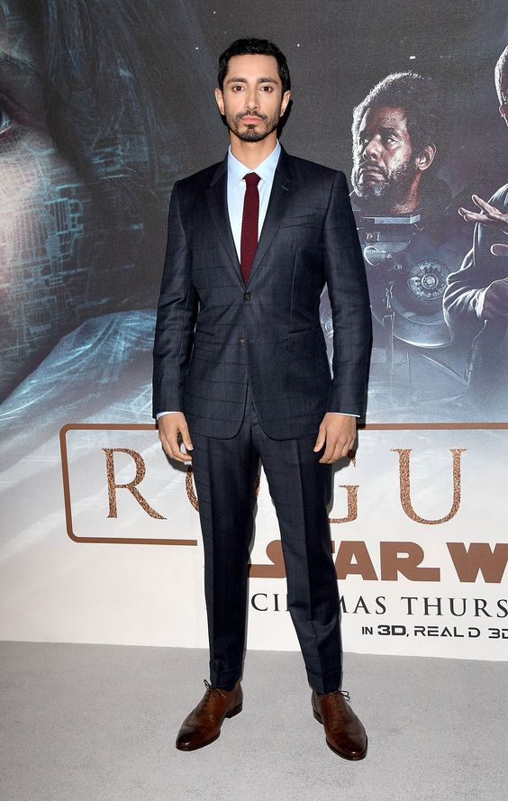 British actor Riz Ahmed wearing Burberry tailoring to the Rogue One: A Star Wars Story premiere in London