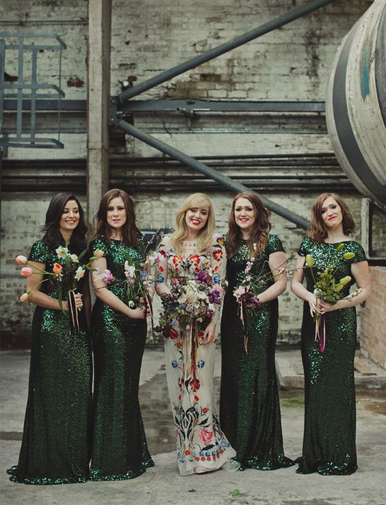 Emerald bridesmaids' gowns will add a dramatic flair a dark green wedding day.