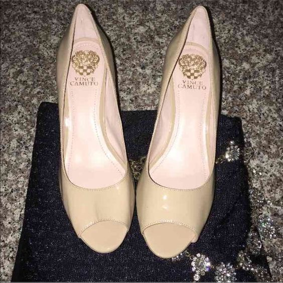 Vince Camuto Heels Open Toes, new with out tags...never been worn Color: Nude/ Dark Beige Size: 9 Open to negotiations Vince Camuto Shoes Heels