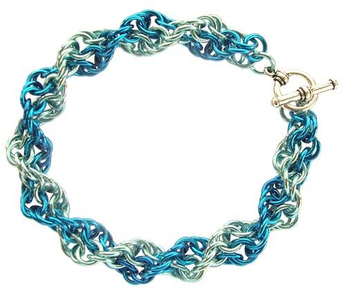 Inverted Spiral chain maille bracelet made using anodised aluminium. This weave holds its shape and doesn't untwist - it looks great when made using two colours. Free tutorial online.