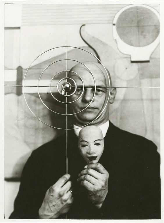 Oskar Schlemmer (German, 1888 – 1943)    with mask and metal object, 1931  Oskar Schlemmer Archive. Staatsgalerie Stuttgart, Germany