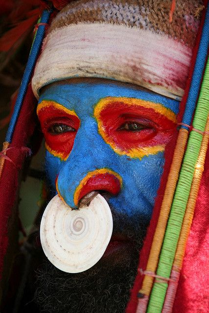 Papua New Guinea... face paint and nose decoration.