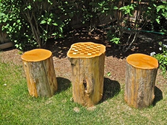 Tree Stump Checker Board Table Grounded In The Garden