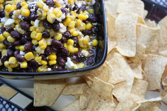 """Corn, Black Bean & Feta Salsa...yum. I made this with cream corn so it was a little more """"dippy,"""" but really the grocery store was out of cheap canned corn"""