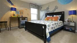 Young boy or teen room with robots and space ship design painted on the walls.