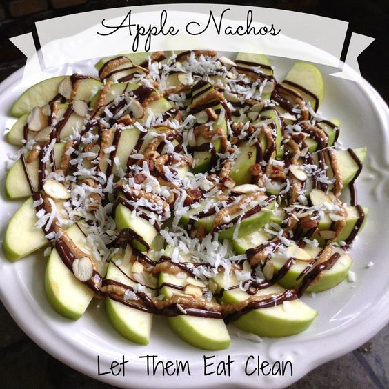Let Them Eat Clean: Apple Nachos! Holy yum! Bedtime snack = Fat + Carbs.  2 large Granny Smith Apples 1/4 cup Almond butter 1/4 cup Extra dark chocolate chips melted 1/4 cup Shredded raw coconut Nuts of your choice