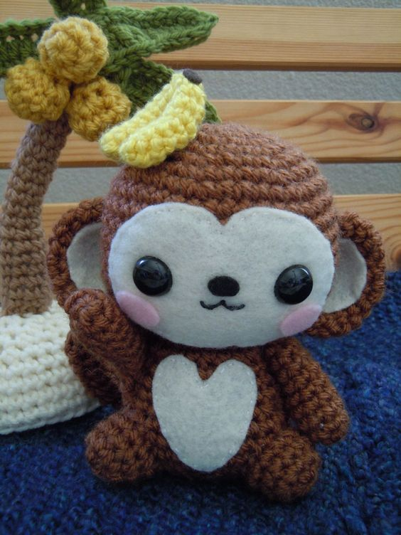 A super cute amigurumi monkey. I am definitely making one ...