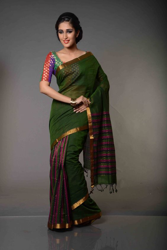 Charu Hasini Tricolor Striped Mangalgiri Cotton Saree : Striking stripes of three colours, all contrasting each other and yet religiously following one another with just a thin line of gold separating them, Charu Hasinitricolor striped Mangalgiri Cotton Saree is a gift of Mangalgiri Sarees to the world. Made of pure and durable cotton woven on a pit-loom, this Mangalgiri saree is a paragon of Mangalgiri Handlooms.