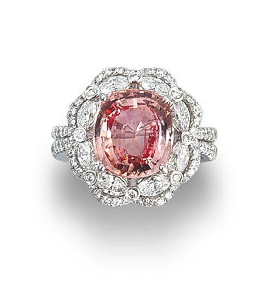 yes please - A padparadscha sapphire and diamond ring  Set with a cushion-cut padparadscha sapphire, weighing 5.23 carats, within an openwork double-tiered surround of marquise and round brilliant-cut diamonds, between diamond-set split shoulders, mounted in 18k white gold, the diamonds estimated to weigh approximately 1.40 carats in total