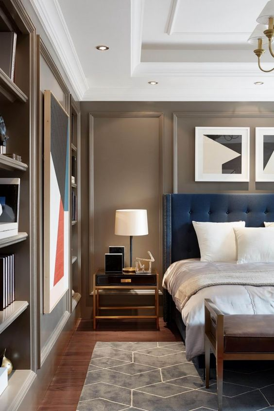 masculine style bedroom in taupe and blue.