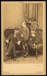 Abraham Lincoln and Mary Todd Lincoln's sons, Willie and Tad posed with family member, William Wallace Todd. (c. 1861).