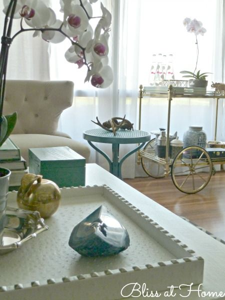 JESSEd White Ostrich Bar Tray JESSEd home is a line of tableware designed with home entertaining in mind. It's glamorous and chic yet practical and affordable. Each tray, tablecloth, and place mat is made from quality faux animal skins and made to last. -Bliss At Home