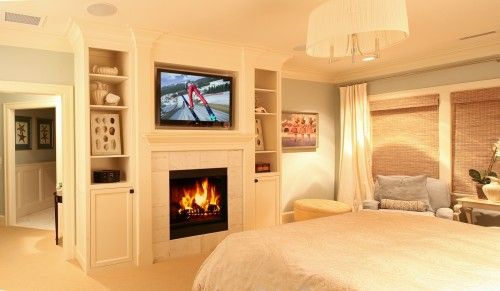 built-in in bedroom with fireplace