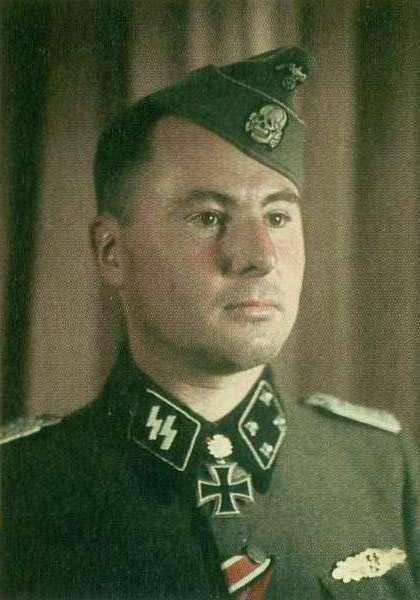 "✠ Léon Degrelle (15 June 1906 – 31 March 1994) RK 20.02.1944 SS-Hauptsturmführer d.R. Führer 5. SS-Frw-Sturm-Brigade ""Wallonien"" / 8. Armee / HGr Süd [subordinated to 5.SS-PD ""Wiking""] [EL o.Nr.] 27.08.1944 SS-Sturmbannführer Kdr 5. SS-Frw-Sturm-Brig ""Wallonien"""