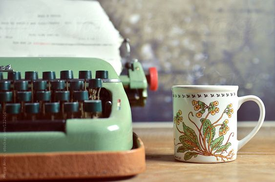 Vintage retro typewriter and cup of coffee with cookie on wooden desk by MarijaAnicic3004 | Stocksy United