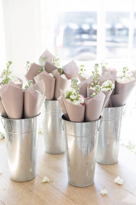 white-flowers-in-buckets http://itgirlweddings.com/tips-for-creating-a-photo-worthy-bridal-shower/
