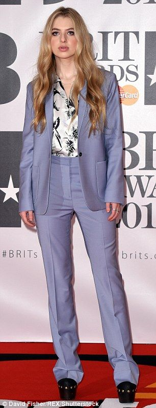 Purple reign: The 16-year-old daughter of Noel Gallagher and Meg Mathews arrived at the bash held at London's 02 arena wearing a lilac trouser suit which was Seventies inspired