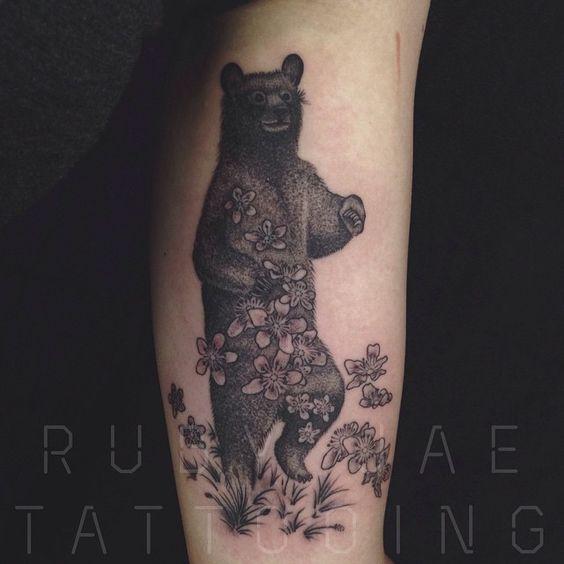 Adventuring black bear! And raspberry flowers!