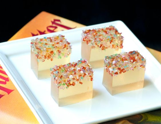 Champagne jello shots with sparkle sprinkles.