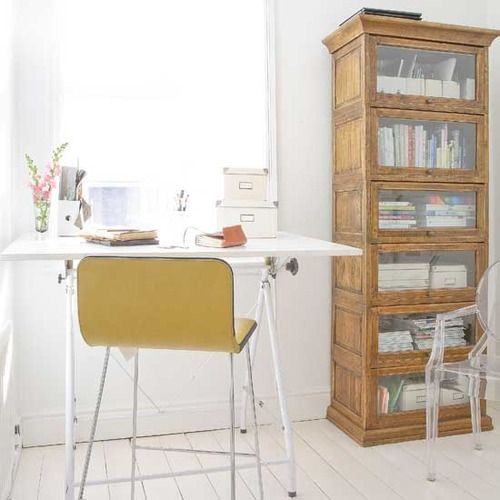 I love the colors and design of this office space: crisp and clean and modern, but warm and worn at the same time.