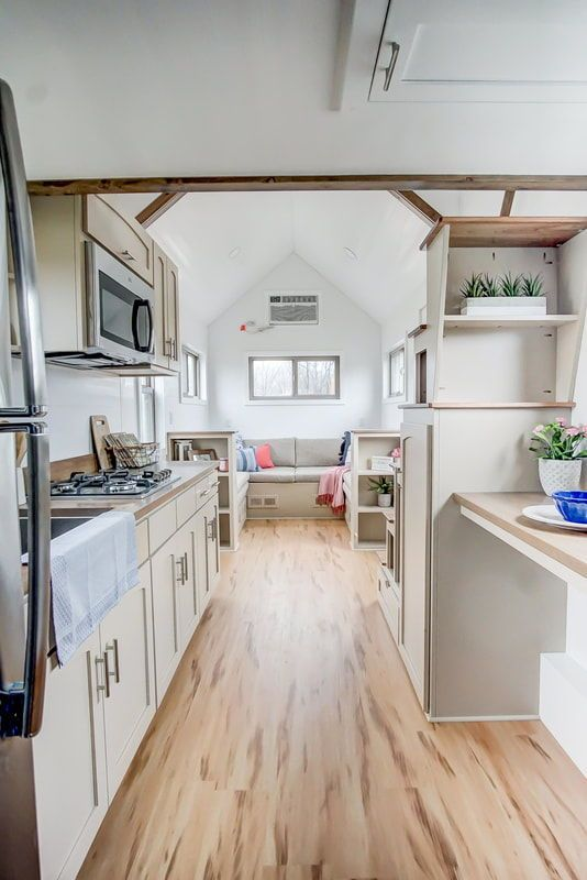 Inside You Ll Find The Signature Kokosing Living Room With Its Built In Benches With Storage Two Bo Tiny House Kitchen Best Tiny House Tiny House Floor Plans