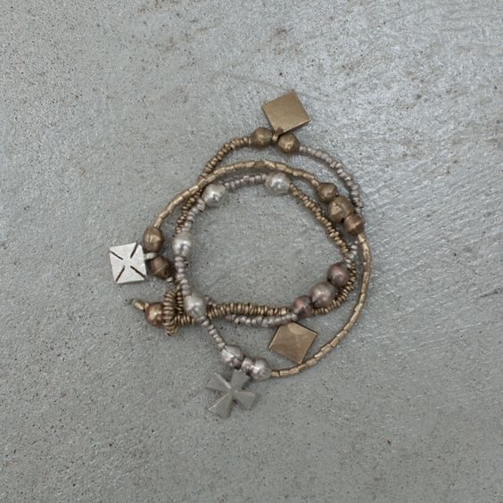 Lovely charm bracelet from Raven + Lily.  Bronze, silver and copper.