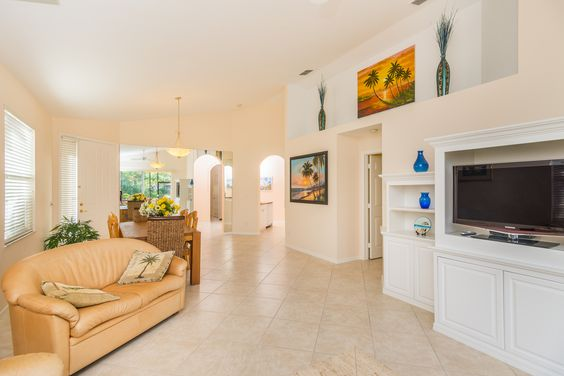 Features include 19 inch tile throughout main living area and lanai, new carpet, freshly painted interior, remodeled shower in guest bath, new sliders and screen doors, new blinds and newer AC.