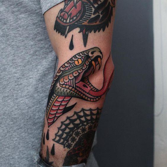 Snake head between some rad tattoos by my friend @jonastattooing @tonybluearms
