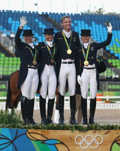 The German team of Isabell Werth, Dorothee Schneider, Sonke Rothenberger and Kristina Broring-Sprehe pose after winning the team gold during the final day of the Dressage Grand Prix event on Day 7 of the Rio 2016 Olympic Games held at the Olympic Deodora Equestrian Centre on August 12, 2016 in Rio de Janeiro, Brazil.
