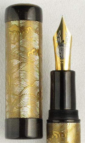 Kaijin Nami Wave. Consistent with the wave motif, this fine art fountain pen exploits a variety of materials to effect a sense of transparency and luminosity. Mother-of-pearl slabs are precisely cut and fitted around the cap and barrel of this pen providing a translucent base for the wave motif. The wave itself, made of urushi lacquer mixed with powdered solid gold is clarified and brushed onto the surface.
