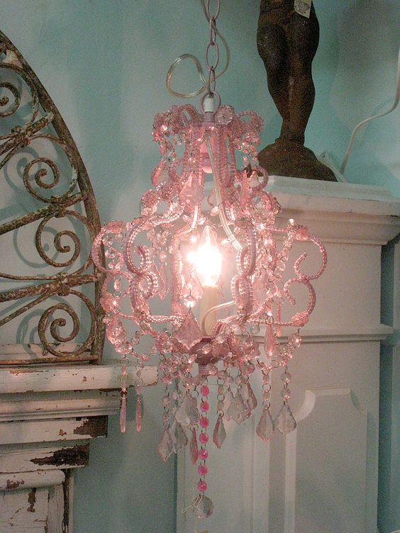 Cute chandelier (Hobby Lobby?)! Fake mantle with wrought iron on top