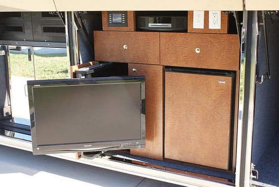 """Entertainment Bay with 55"""" TV, Bose Surround Sound and of Corse a Fridge for your Favorite Frosty Beverage!"""
