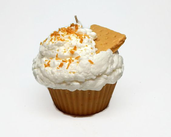 This cupcake candle is approximately 11 ounces. The cake portion is dark vanilla. Frosting is white topped with a wax graham cracker wedge and