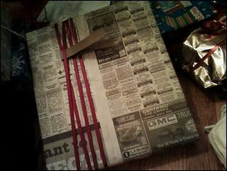 Just newspaper for wrapping paper, with ribbon to dress it up a little and a cardboard tag.