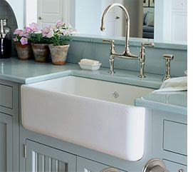 The farm sink or the apron sink and I LOVE the faucets!