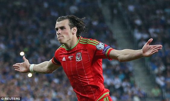 Gareth Bale celebrates scoring his first goal of the game during Wales' 3-0 victory agains...