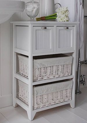 Side view of the white bathroom storage furniture with 2 large willow drawers and 2 wooden drawers