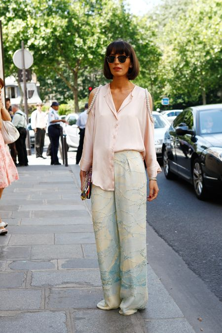 """""""Stylist Natuka Karkashadze's pearl-adorned, cutout sleeves and printed embellished trousers were a perfect look for the couture shows. She definitely set the tone for couture casual chic. Brava! """" - Tamu McPherson"""