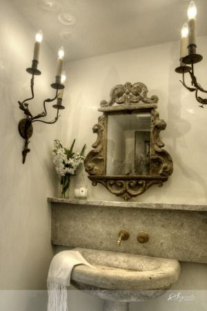 Bathroom with antique stone sink. Segreto Finishes. Come see more interior design inspiration with Exquisite Plaster Walls, Finishes and Segreto Stone.#plaster #walls #finishes #segreto #interiordesigninspiration