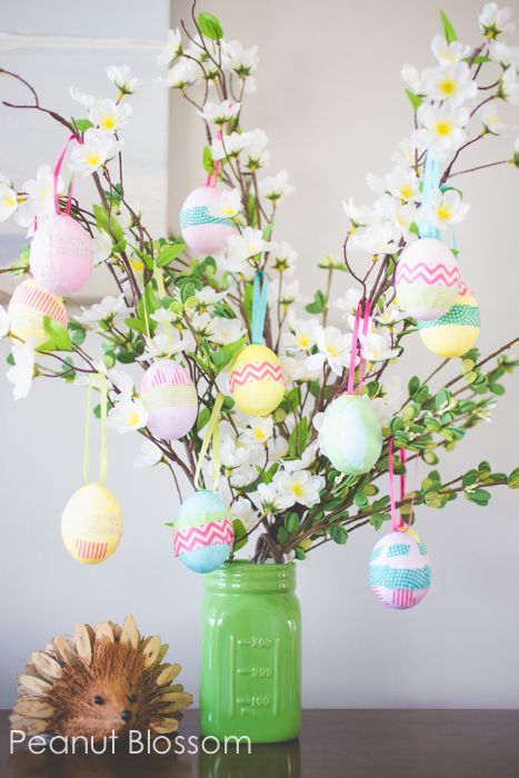 "Hang your decorated Easter eggs on a sprigs of silk flowers for a festive ""tree."" Get the tutorial at Peanut Blossom.:"