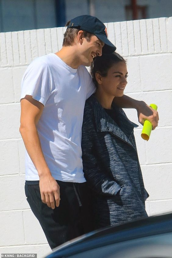 Mila Kunis and Ashton Kutcher pack on the PDA while walking arm in arm through Los Angeles | Daily Mail Online