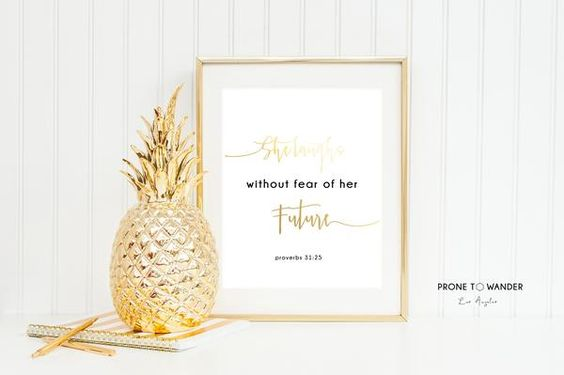 """""""SHE LAUGH WITHOUT FEAR OF HER FUTURE."""" Physical art print in gold foil."""