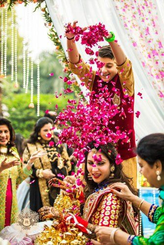 PICTURES THAT PROVE EVERY INDIAN BRIDE MUST GET A PICTURE WITH A FLOWER SHOWER   A bridal entry in style   Ceremonies are more animated   Must have picture with your little brother indian weddings   Curated By Witty Vows   The ultimate guide for the Indian Bride to plan her dream wedding. Witty Vows shares things no one tells brides, covers real weddings, ideas, inspirations, design trends and the right vendors, candid photographers etc. #bridsmaids #inspiration #IndianWedding…