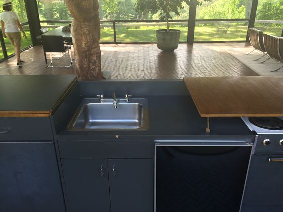 I loved his idea that the sink & cooktop can be concealed entirely in the cabinetry by folding over two hinged countertop pieces. Johnson and Whitney entertained countless art & cultural world luminaries there so this option probably came in handy.