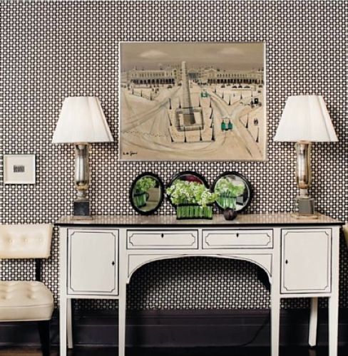 love the black and white wallpaper and the credenza