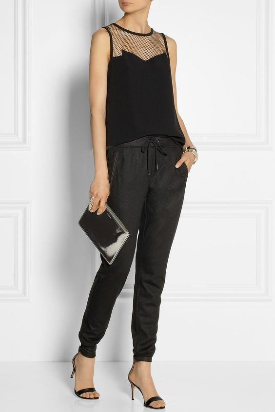 Rag & bone | Franklin mesh-paneled crepe top and pants, Gianvito Rossi heels, and Jil Sander clutch.