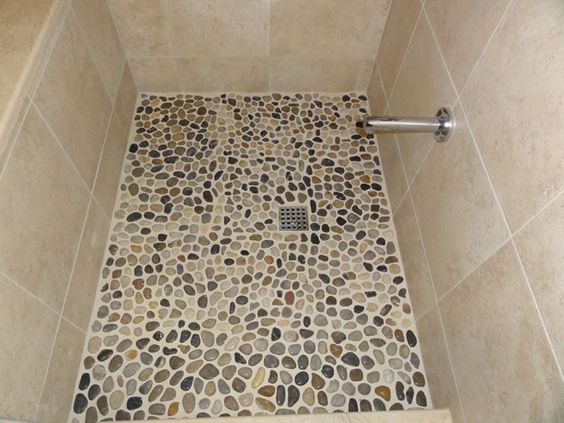 Maybe w dark grout bathroom pinterest floor for Laying river rock