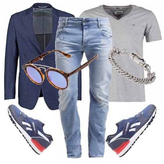 Un look easy ma abbinato accuratamente come insegnano i nostri fashion blogger maschili. Vediamolo meglio nel dettaglio: jeans chiari vissuti indossati arrotolati alla caviglia, t-shirt basic con piccolo scollo a V che trovo decisamente sexy, giacca in jersey effetto jeans, Reebok classic sempre con dettagli in jeans, occhiali Ray-Ban che lasciano intravedere lo sguardo, e completo il look con un bracciale in metallo.