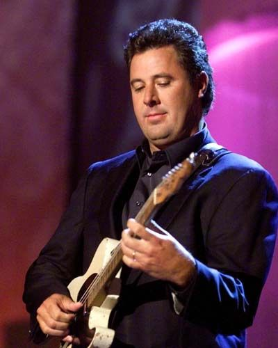 Vince Gill - super guitar player, beautiful voice.  He's very funny too.